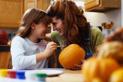 Mother and Daughter Painting a Pumpkin